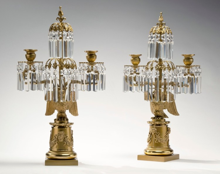 Pair of Brass Candelabra by Messenger & Phipson: The central standard raising a finial above an umbrella of leaves dripping lusters above another such umbrella flanked by a pair of candle arms with lusters hanging from the bobèche above a cast eagle perched on a cylindrical pedestal with applied foliate swags on a square plinth base. Stamped on the back of the base is: MESSENGER & PHIPSON.
