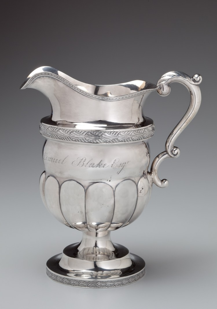"Coin Silver Presentation Pitcher by Farnum & Ward, having an applied stamped decorative band above a mellon-lobed bowl on a footed stand, Engraved: ""New England Guards to Lemuel Blake Esq."""