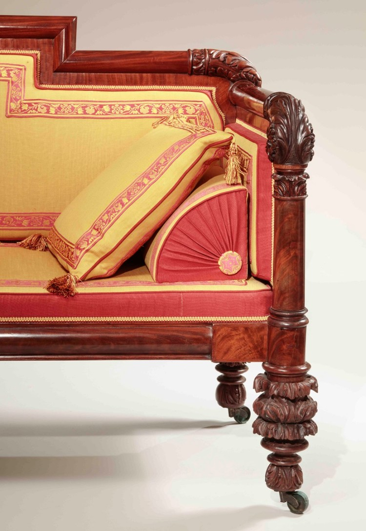 Carved Mahogany Box Sofa front detail view of elaborately acanthus-carved hand rest and feet and beautifully upholstered bolster cushions.
