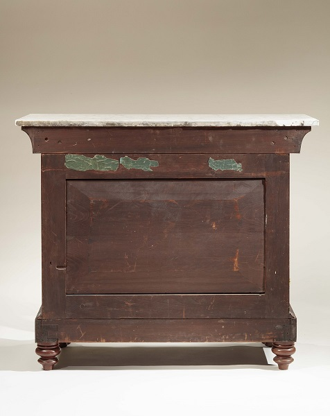 PAIR OF RESTAURATION GILT-STENCIL-DECORATED MAHOGANY PIER TABLES: Back side of one table showing beveled panel.