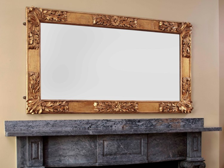 Carved Gold-leaf Over-mantle Mirror with paneled and gilded rectangular frame with bold acanthus leaf carving at the corners and mid-span between the corners holding the original single heavy plate glass.