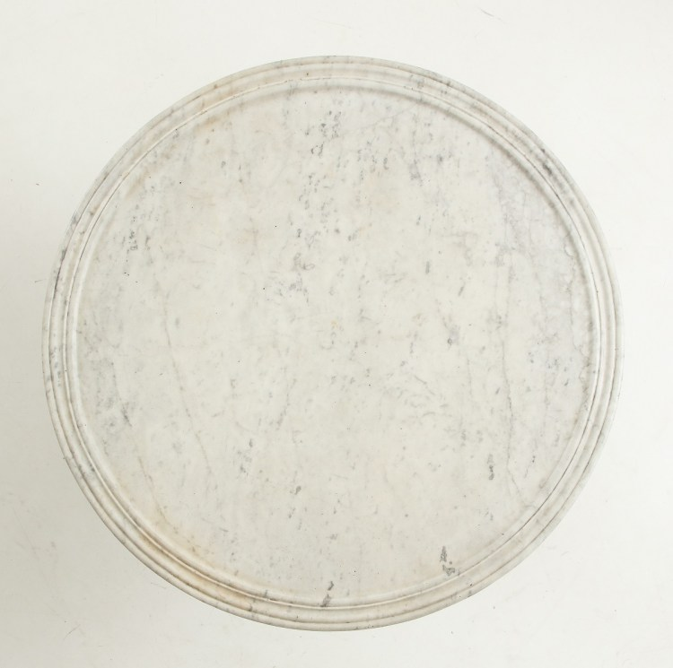 Full view of circular marble top with molded edge.