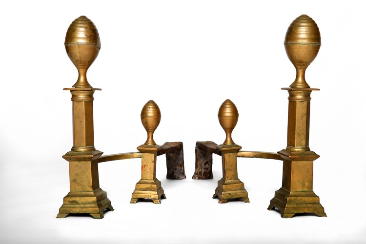 """Pair of Classical Brass """"lemon-top"""" Andirons, The lemon-shaped finials on a plinth above a hexagonal pillar set on a square pedestal with stepped, molded base with bracket feet, each with a curved arm connecting to a conforming log stop and iron billet bar.  Each with impressed mark on the brass covering of the billet bar behind the log stop: J. DAVIS/ BOSTON."""
