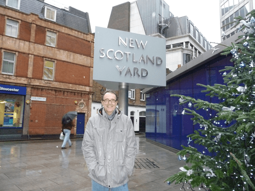 visitng the New Scotland Yard sign in London