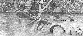Soldiers in Vietnam crossing a river chest deep.