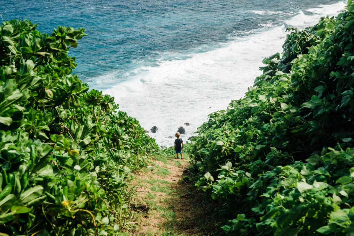 kids hiking on the island of olosega in the national park of american samoa