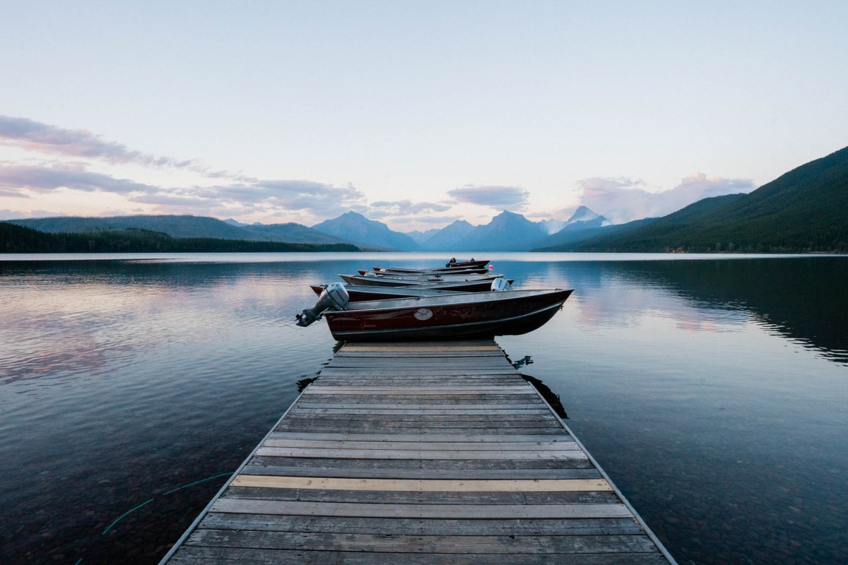 boats on the dock at lake mcdonald in glacier national park