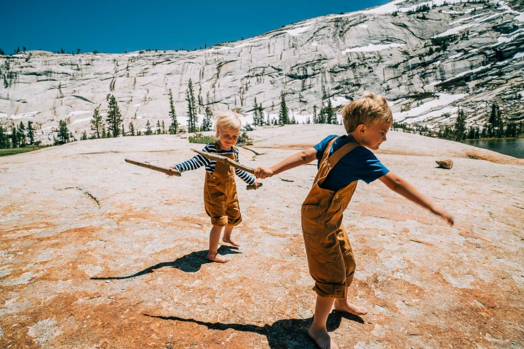 kids playing with sticks at Yosemite National Park