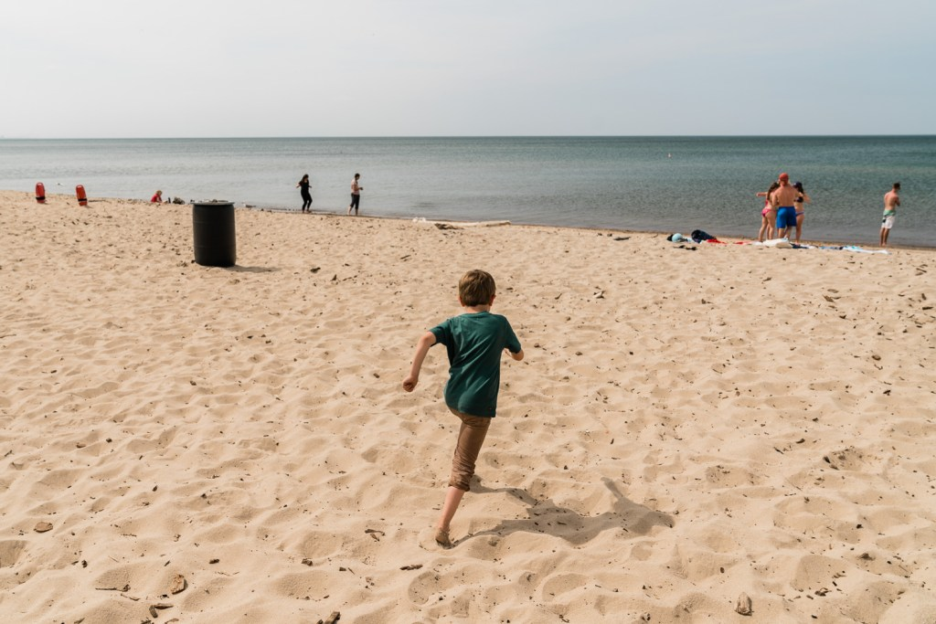 child running on west beach in indiana dunes national park