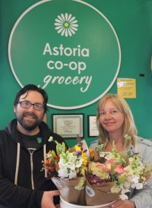 Kathleen (right) and one of her Astoria Co-op Grocery customers (left)