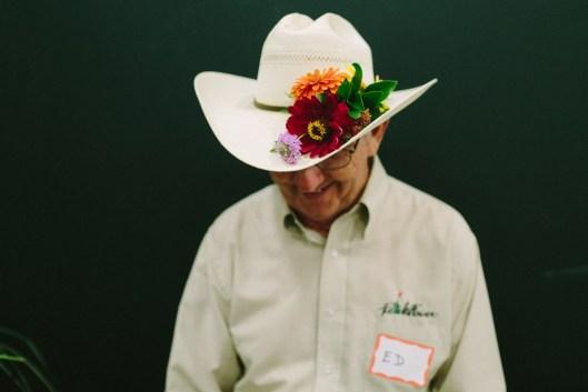 Ed shows off his flower-adorned cowboy hat (c) Angela Zion