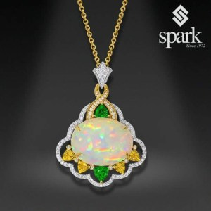 Yellow gold and Opal pendant from Spark Creations.