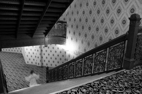ghost of brown palace walking down stairs