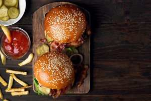 Burgers and fries on a wooden table