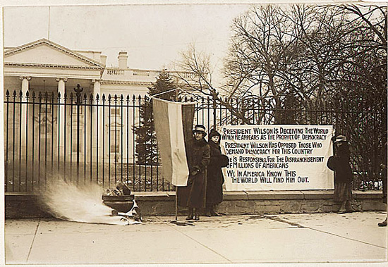 Photograph of suffragettes protesting outside the White House circa 1917 (Courtesy of The Commons on Flickr)