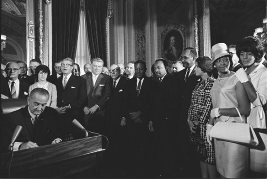 LBJ signing the 1965 Voting Rights Act as Martin Luther King Jr and others look on (Courtesy of the Library of Congress via the Commons on Flickr)