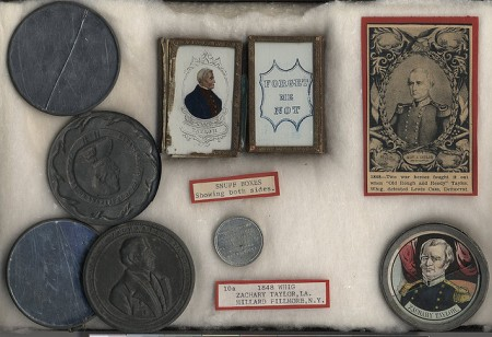 Snuff boxes and campaign medals bearing the image of Zachary Taylor, along with other political ephemera dating from the late 1840s.
