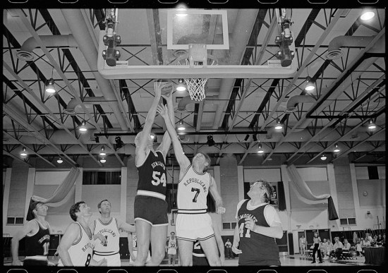 A team of Democrats and a team of Republicans playing basketball.