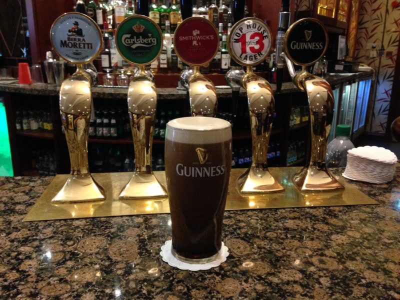 Beer on bar in front of taps - Guinness