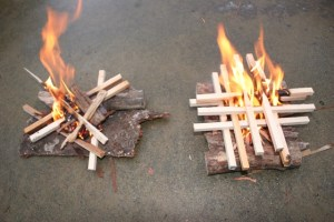 Examples of fires built in just a few minutes using the Lightning Strike. Note the two methods and the bark base plate as well as the stacking of kindling to get a roaring fire going. FIRE needs oxygen and plenty of it, don't smother your fire with too much wood initially, let it breathe.