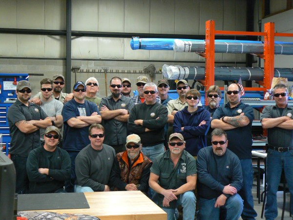 Meet the Bartlein team: (back row) Louie, Ray, Kyle, Jim, John, Todd and Donny; (center row) Joe, Andrew, Kim, Scotty, Ron, Brad, Jeff and Steve; (front row) Justin, Frank Green (founder), Bill, Tracy (founder) and Andy (founder). Other team members include Brian, DJ, Tony, Mike, Tom, Mark, Jesse and Dave, who were hiding around the bundles of steel in the background.