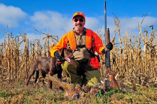 The author and his new pal, 6-month-old Desert, show off a pair of central South Dakota pheasants taken with Browning's newly resurrected A5 Sweet Sixteen shotgun.