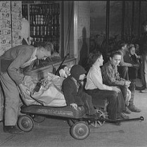 Boys Waiting outside Grocery Store with Wagons for Jobs Delivering Groceries. Greenbelt, MD November, 1942. Photo by Ann Rosener. Library of Congress collections.
