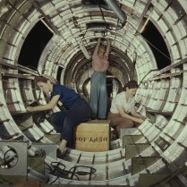 Women workers install fixtures and assemblies to tail fuselage section of B-17 bomber at Douglas Aircraft, Long Beach, CA. October, 1942. Photo by Douglas Palmer. Library of Congress collections