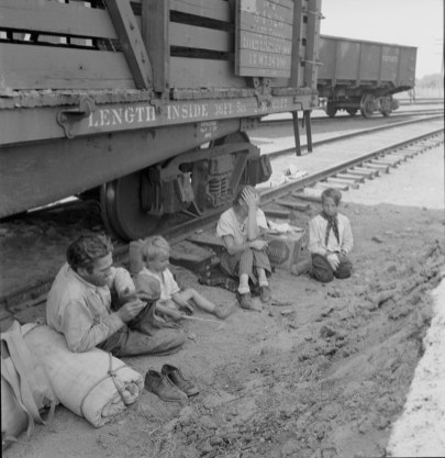 Family Traveling by Freight Train. Yakima, Washington, 1939. Photo by Dorothea Lange.
