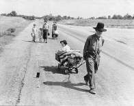 Family walking on highway, Oklahoma, 1938. Photo by Dorothea Lange.