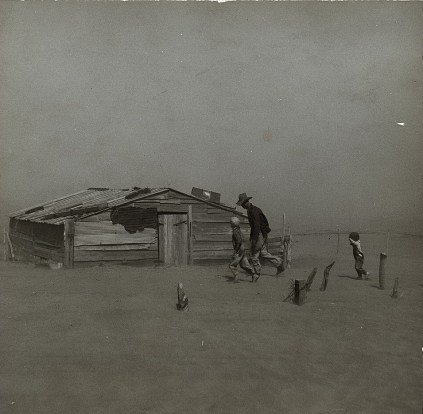 Farmer and sons walking in the face of a dust storm. Cimarron County, OK. April, 1936. Photo by Arthur Rothstein.