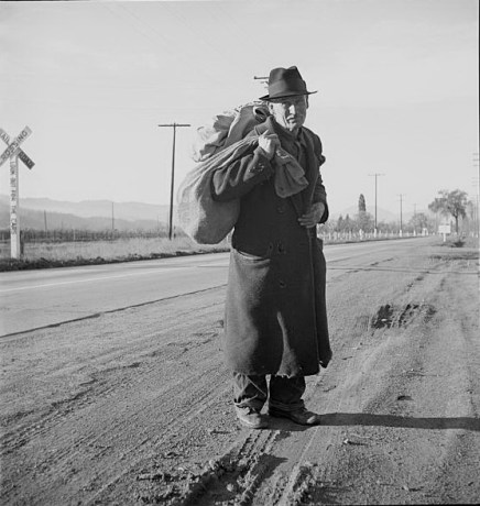 Homeless man carrying belongings. Napa Valley, CA., 1938. Photo by Dorothea Lange.