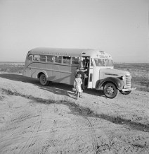 Children Get Into School Bus on a Fall Morning. Dead Ox Flat, Malheur County, Oregon. 1939. Photo by Dorothea Lange.