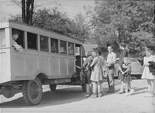 Schoolchildren and bus. Franklin-Heard County, Georgia. April, 1941. Photo by Jack Delano.