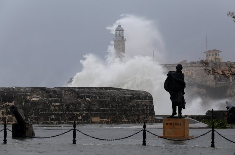 Waves crash onto Havana lighthouse