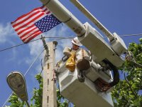 U.S. military contractor fixes a power pole in Puerto Rico (army.mil)