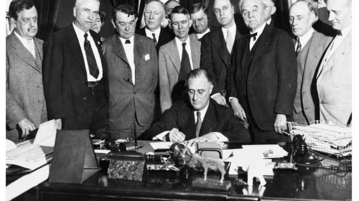 FDR signs the legislation creating the Tennessee Valley Authority (TVA)