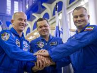 A joint Russian-American crew ready to go to the ISS in 2016. (NASA/Ingalls)