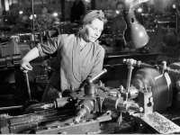 A lathe operator during the economic mobilization for World War II.