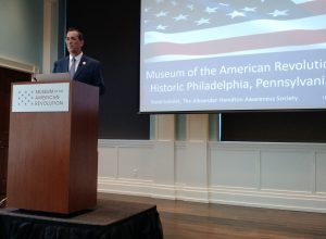 Rand speaking on Hamilton's military history at the Museum of the American Revolution in Philadelphia.
