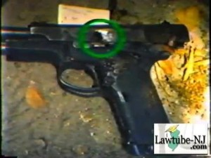 Agent Dove's S&W Model 459 pistol, shown with the damage caused by Platt's .223. [Photo Credit: www.examiner.com]