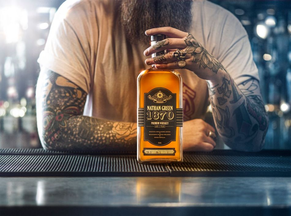 Bartender at Bootlegger in London with the first single barrel release - made available solely in the UK and sold out immediately