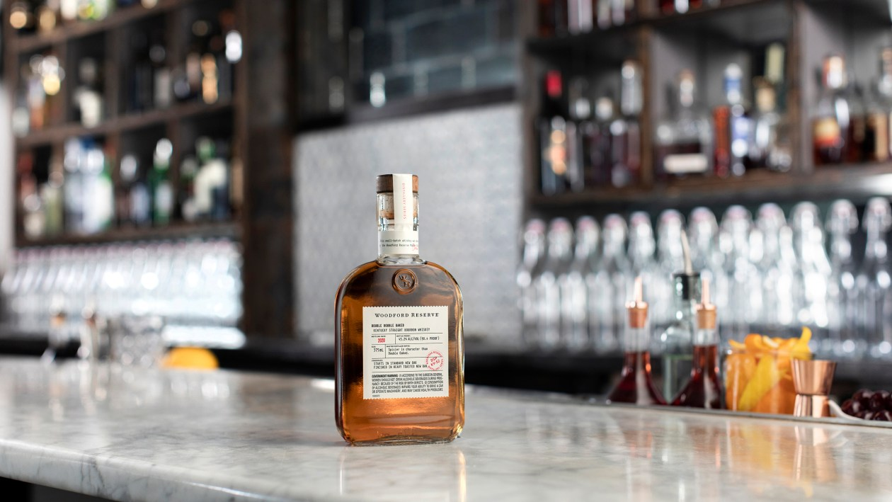 Woodford Reserve Double Double Oaked whiskey on a bar top