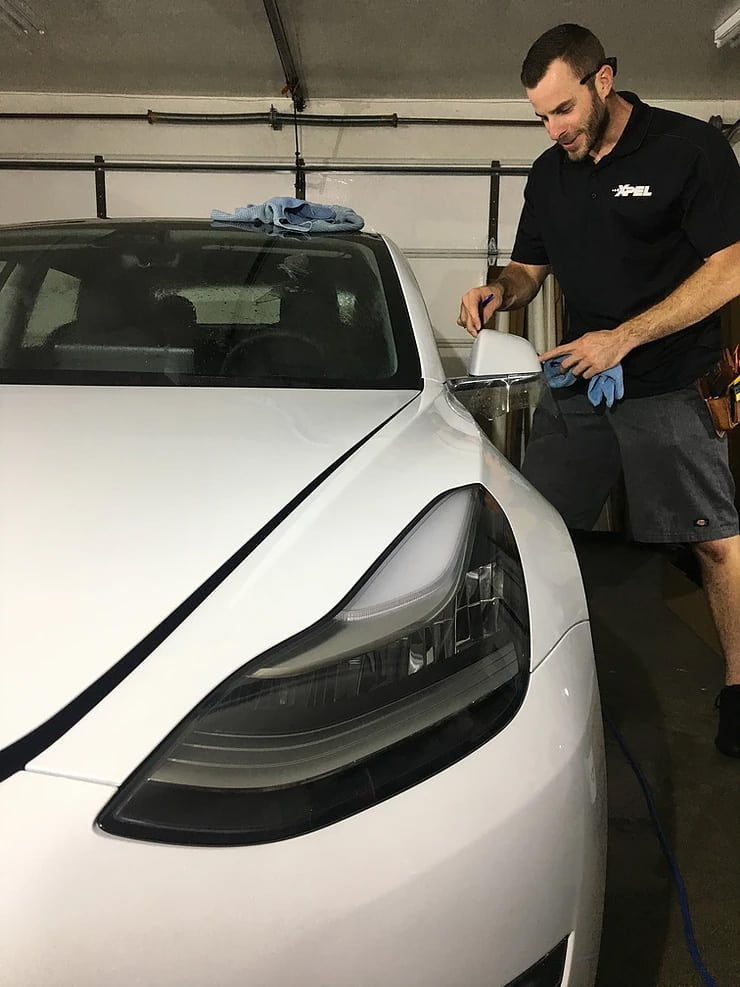 World's Best Paint Protection Installer Tyler O'Hara wrapping rear view mirror