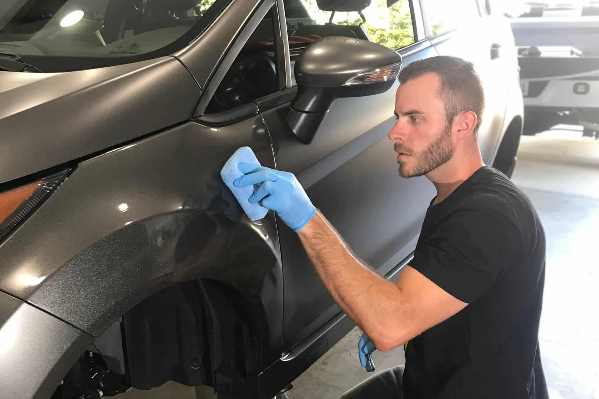 Tyler O'Hara working on ceramic coating