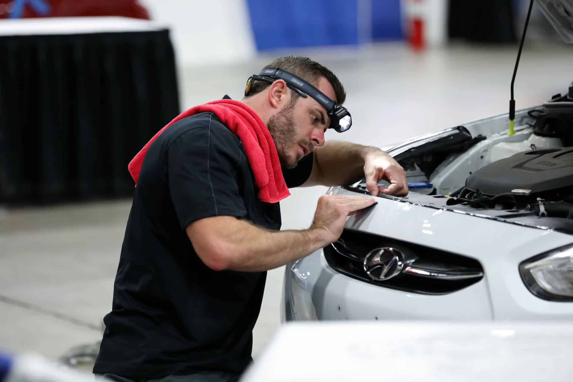 World's best paint protection installer Tyler O'Hara working diligently on this white Hyundai