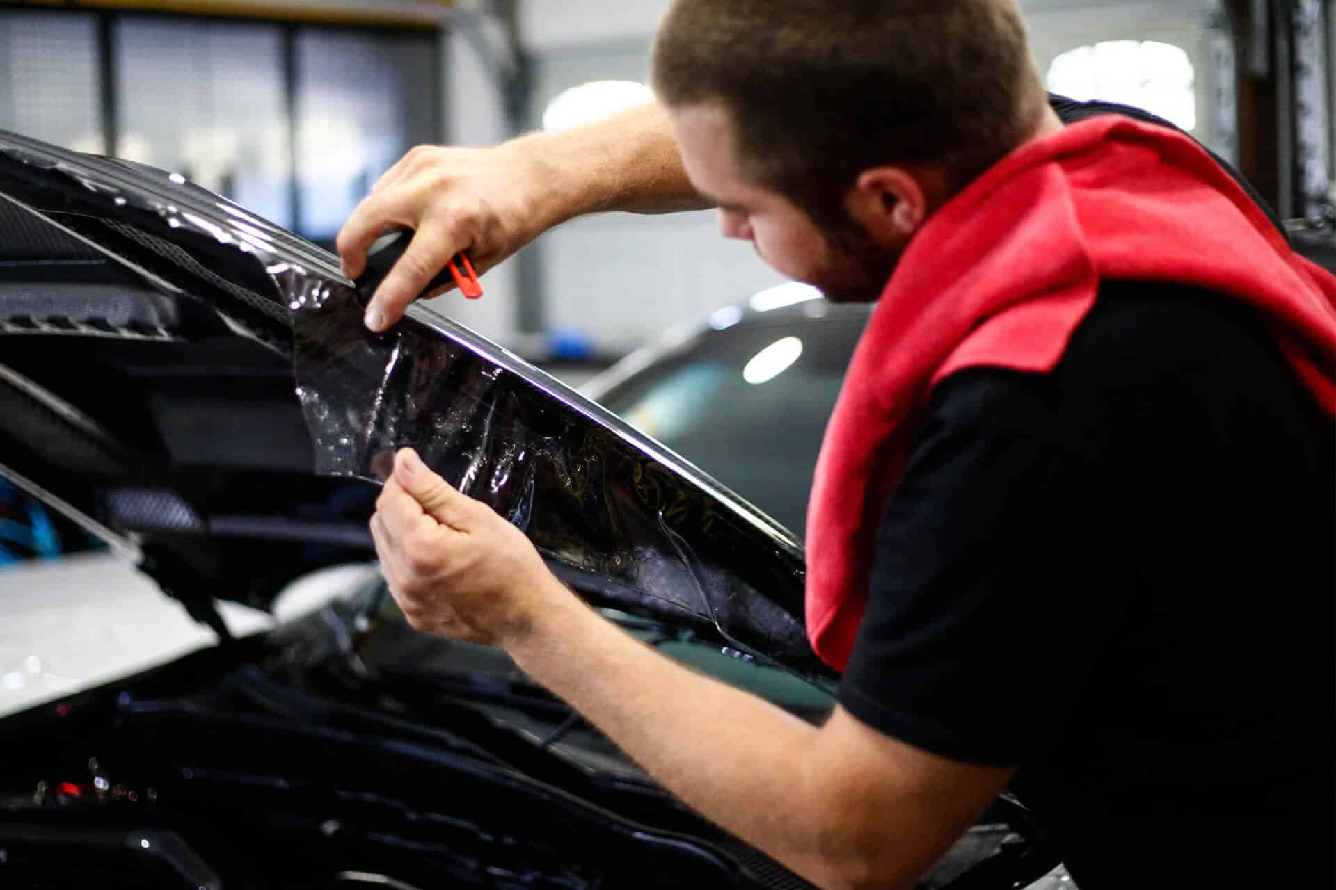 World's Best Paint Protection Installer Tyler O'Hara wrapping vehicle edges