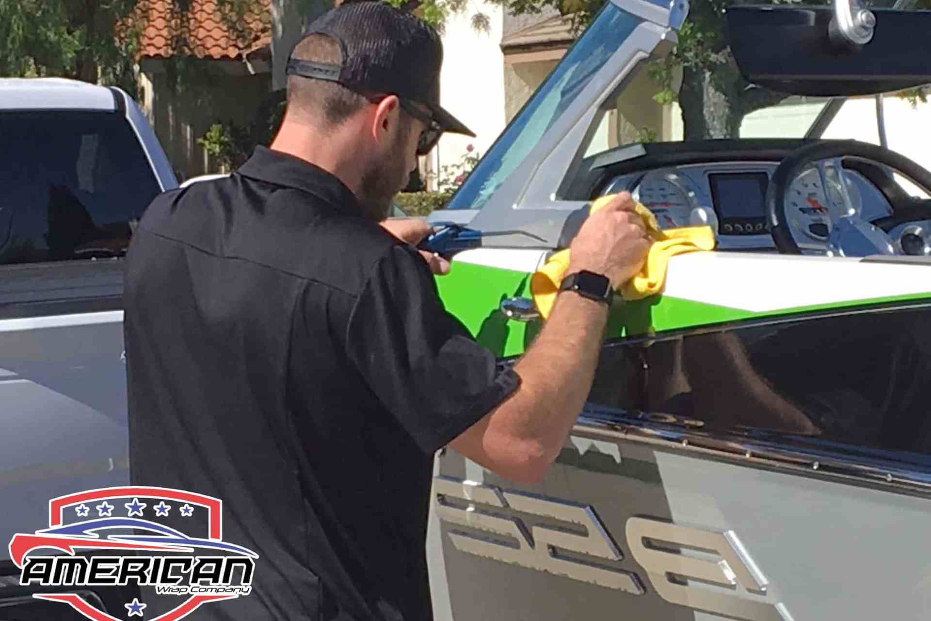 World's Best Paint Protection Installer Tyler O'Hara working on boat