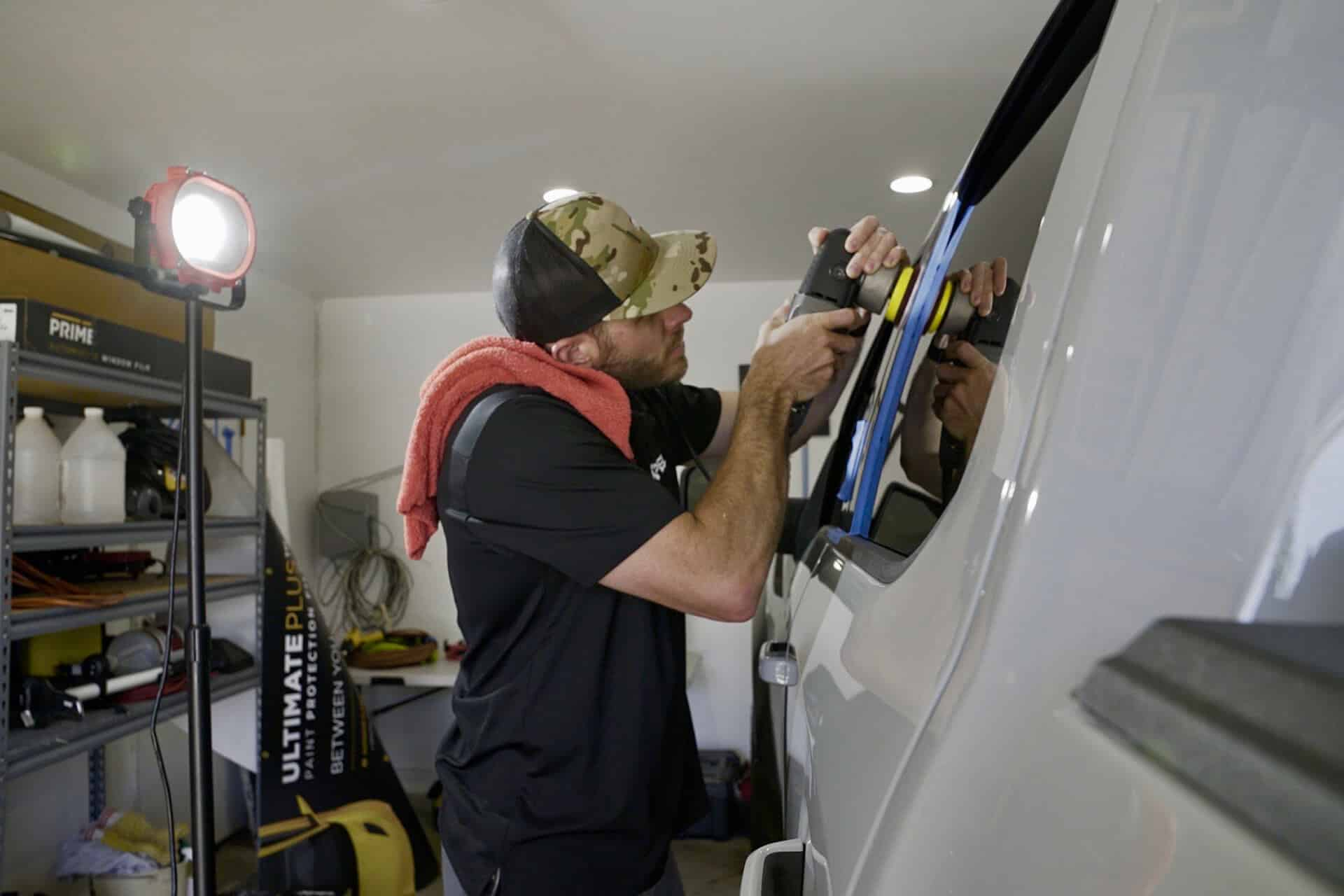 World's Best Paint Protection Installer Tyler O'Hara working on vehicle window