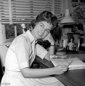 Madelyn Pugh Davis at her desk